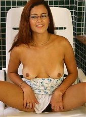 Naughty cam model Leia exposes her breasts and hikes up her skirt to show her bush